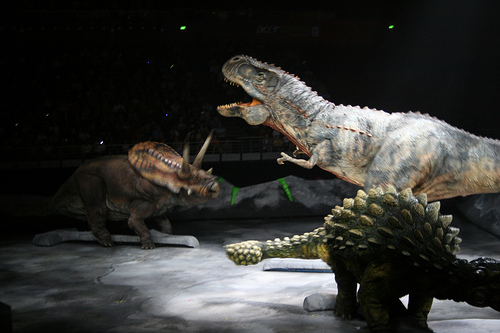 Life-sized fighting dinosaurs.