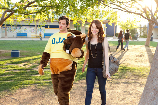 Olive (Emma Stone) talking to Todd (Penn Badgley) in his mascot costume.