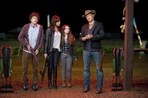 Tallahassee (Woody Harrelson), Columbus (Jesse Eisenberg), Wichita (Emma Stone) and Little Rock (Abigail Breslin) standing next to each other.