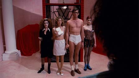 Brad (Barry Bostwick) and Janet (Susan Sarandon) in their underwear accompanied by Magenta (Patricia Quinn) and Columbia (Nell Campbell).