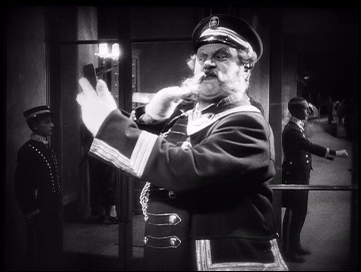 The Doorman (Emil Jannings) checking his beard.