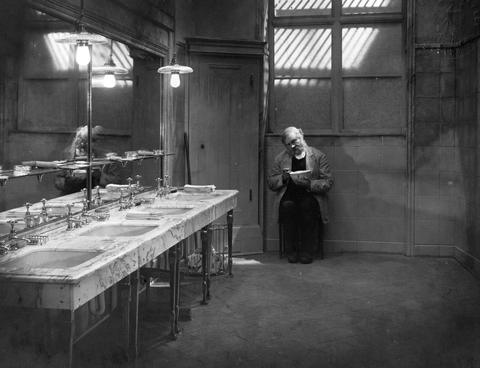 The Doorman (Emil Jannings) relegated to washroom clerk.