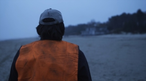 the-man-in-the-orange-jacket1