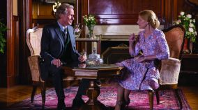 Bill Nighy and Patricia Clarkson sitting at a table, having tea.