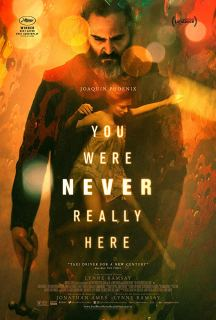 The film poster showing Joaquin Phoenix with a hammer in his hand, looking down with an image of Ekaterina Samsonov floating in water superimposed over his body.