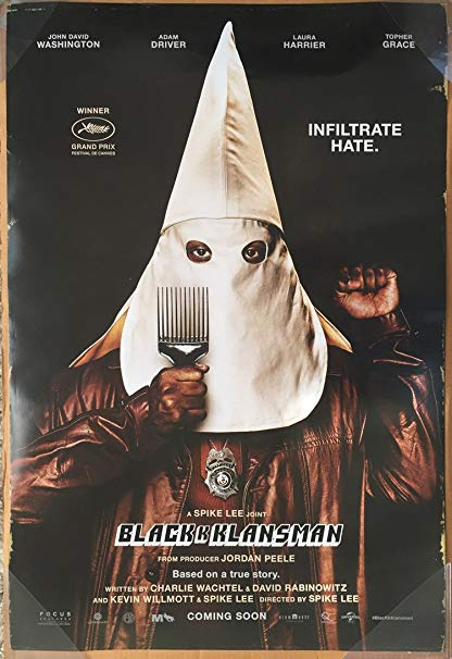 The film poster showing a black man in a Ku Klux Klan mask, making a black power fist and holding up a comb.