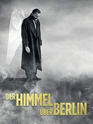 Film poster showing Bruno Ganz with wings looking of a the edge of a skyscraper.