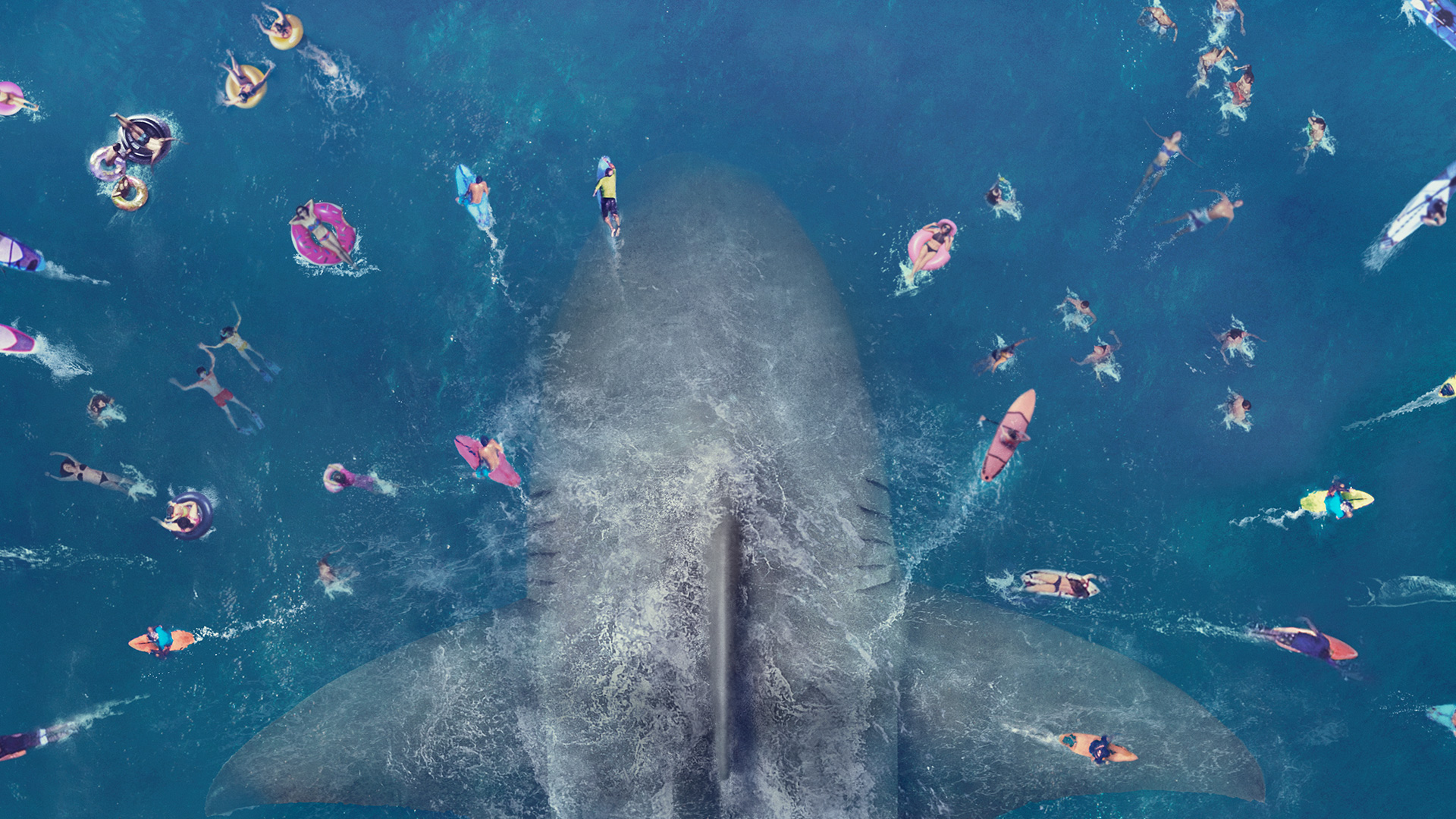 A shark underneath a crowd of swimmers.