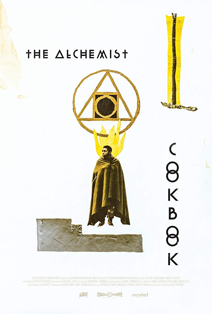 The film poster showing Ty Hickson draped in a blanket and some occult symbols.