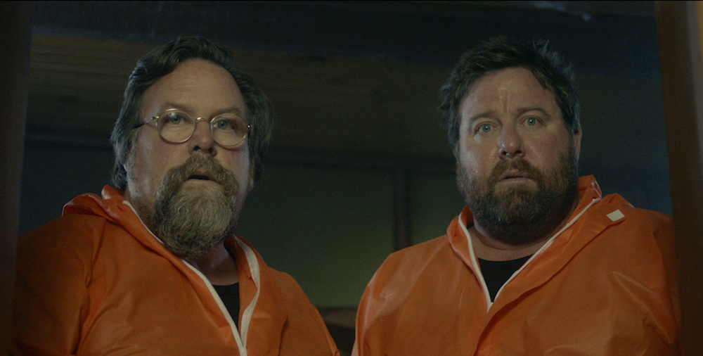 Clayton and Shane Jacobson in the film.