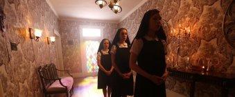 Film still showing three nuns in a corridor.