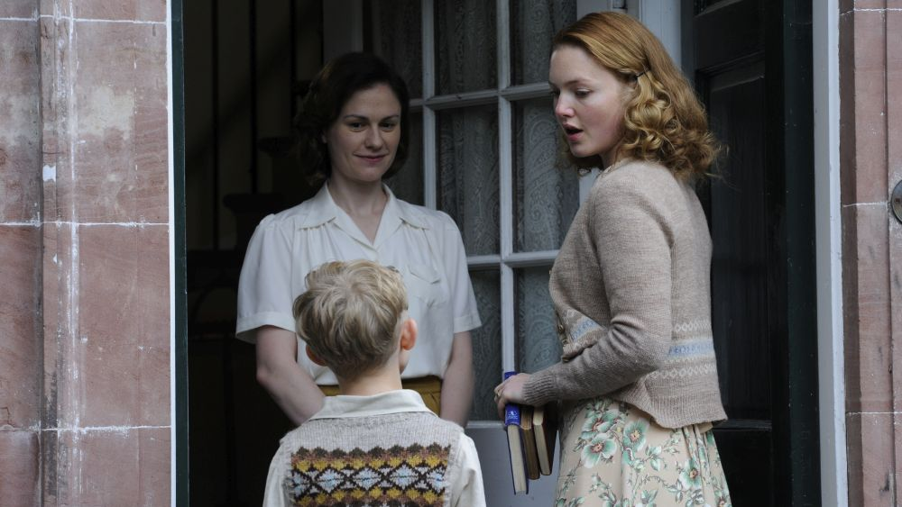 Anna Paquin, Holliday Grainger and Gregor Selkirk in the film.