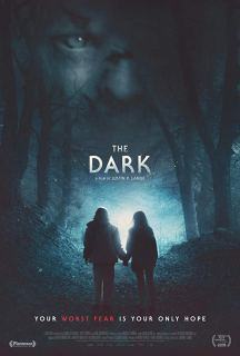 The film poster showing the silhouettes of two kids holding hands in the woods.