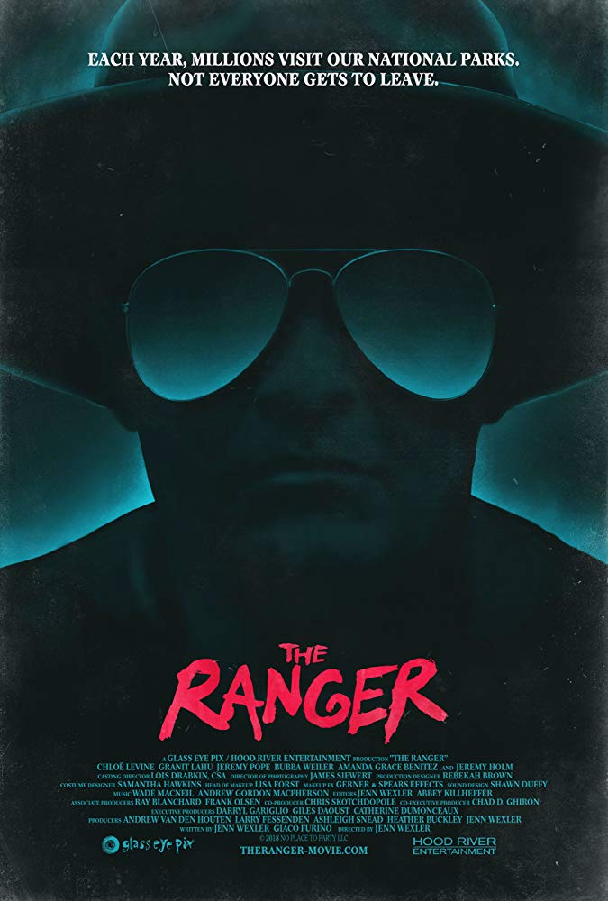The film poster showing a man in a hat and with sunglasses in shades of blue and black.
