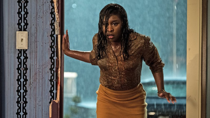 A young woman (Cynthia Erivo) coming in from the rain, drenched from top to bottom.