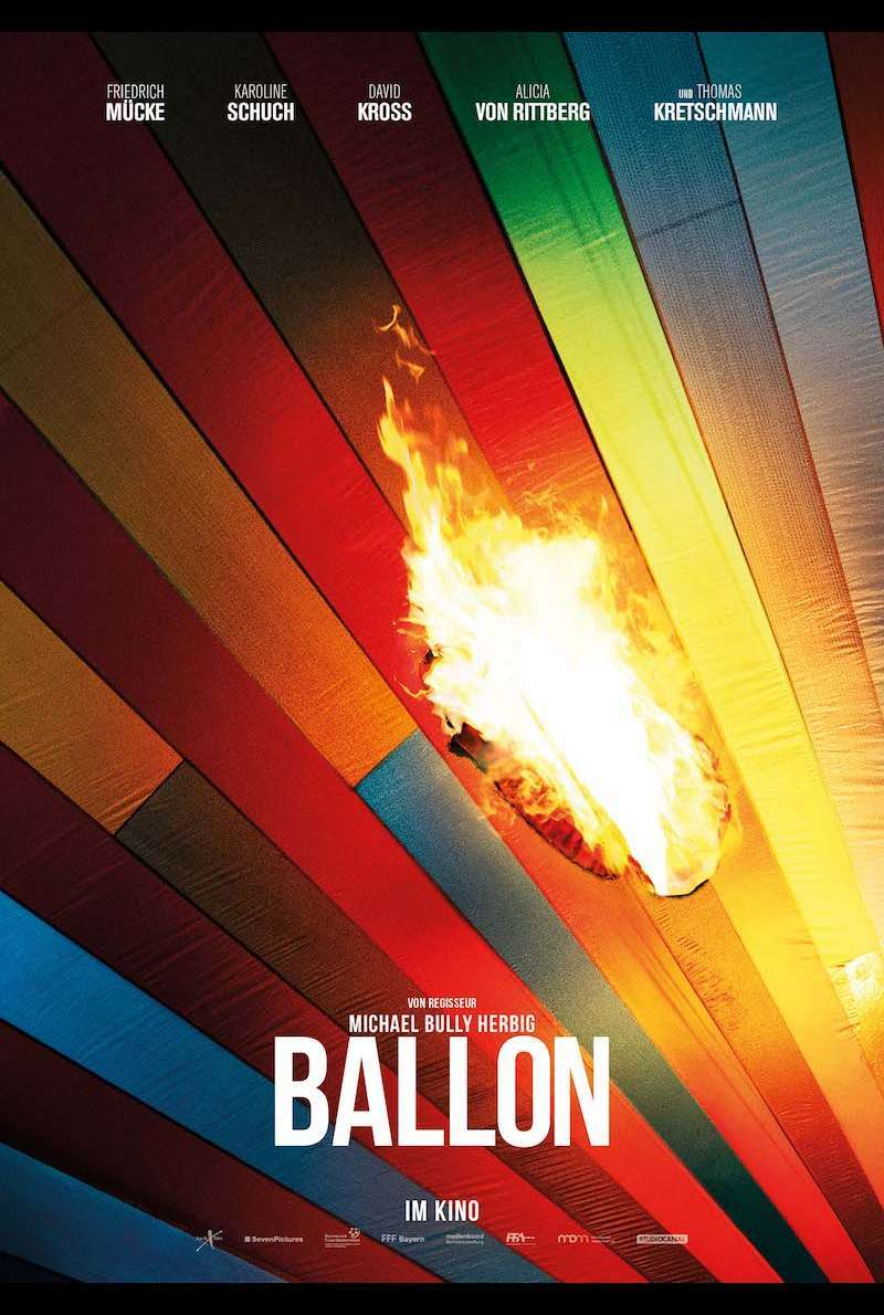 The film poster showing balloon silk burning.