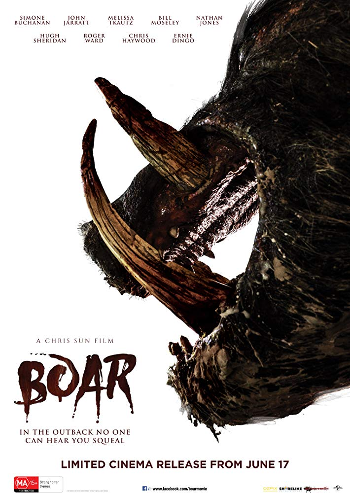 The film poster showing a boar head with an open mouth and massive fangs in profile.