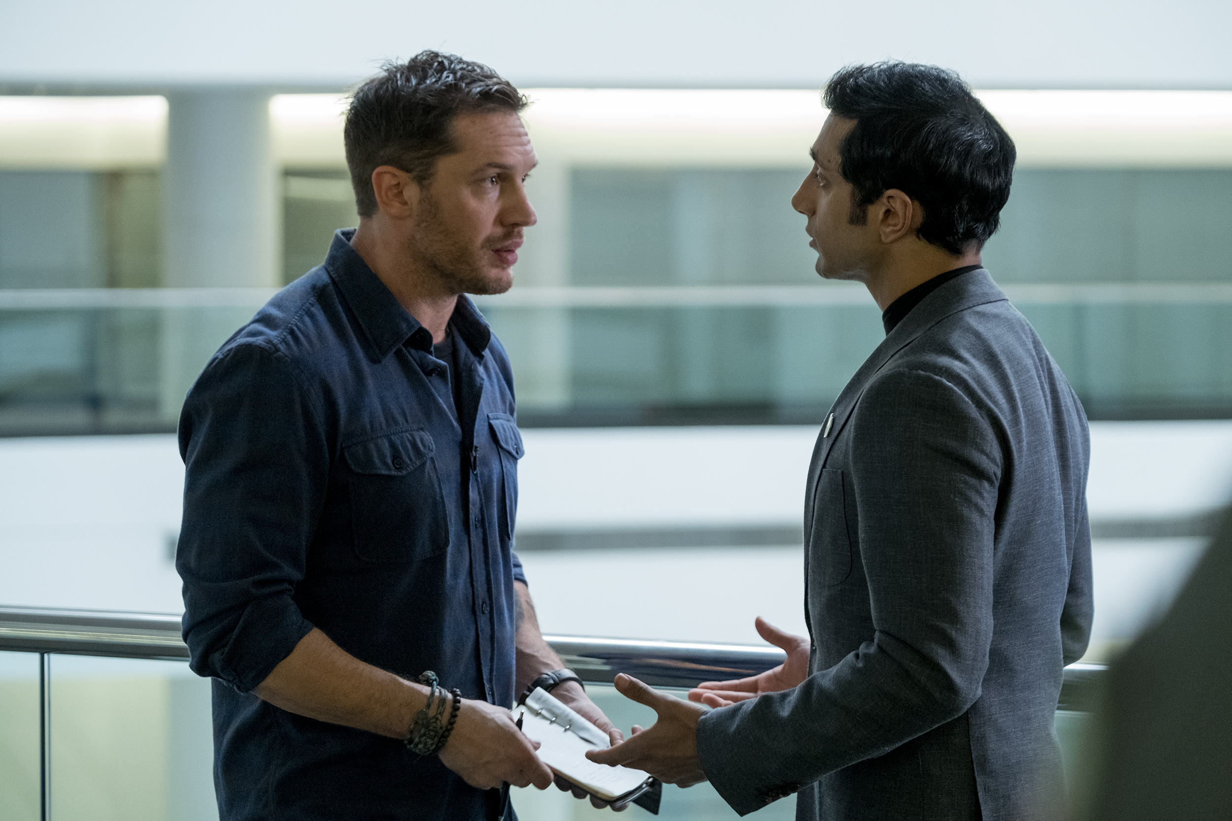 Two men (Tom Hardy, Riz Ahmed) talking to each other.