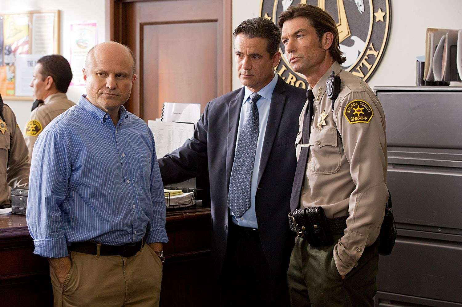 Keith Mars (Enirco Colantoni) with Cliff McCormack (Daran Norris) and Sheriff Dan Lamb (Jerry O'Connell).