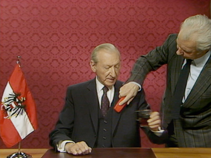 Waldheim just before a TV talk, getting his suit brushed.