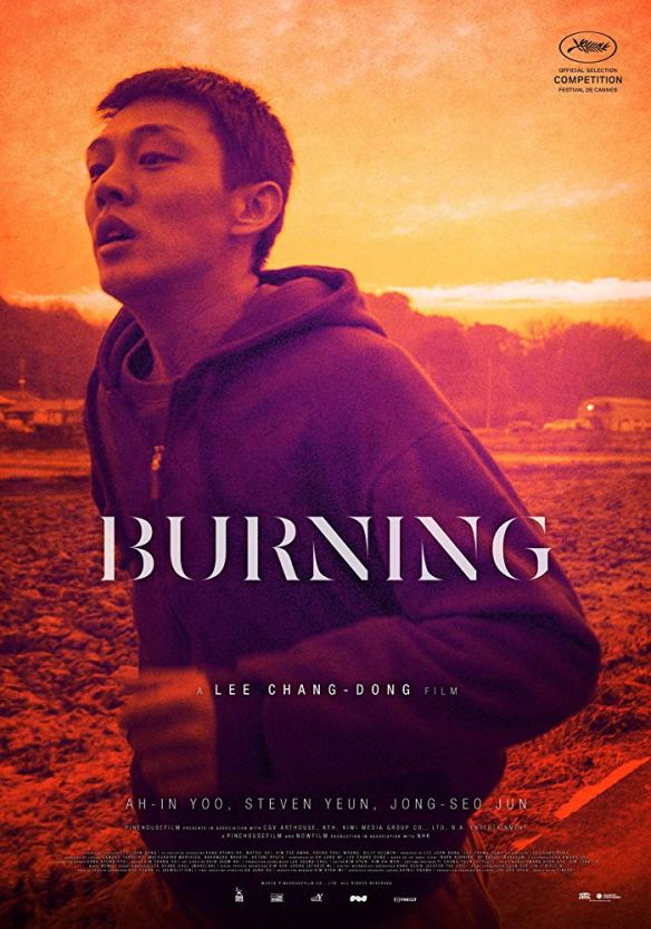 The film poster showing a man in a hoody running through a sunset landscape.