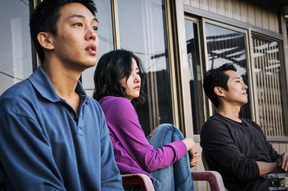 Three young people (Ah-in Yoo, Steven Yeun, Jong-seo Jun) sitting on a porch.