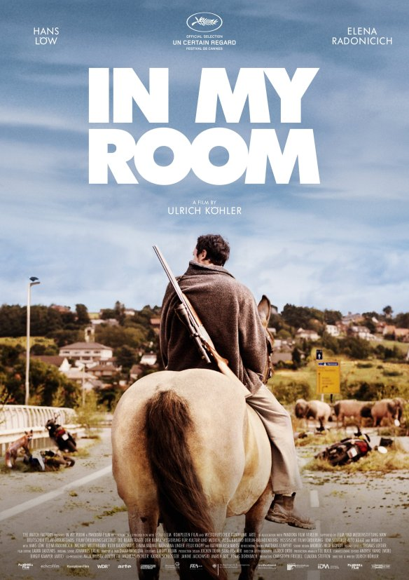the film poster showing a man riding a horse in a desolate landscape.