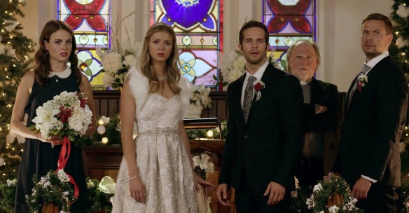 Bride, groom, bridesmaid and best man at the altar, looking shocked.