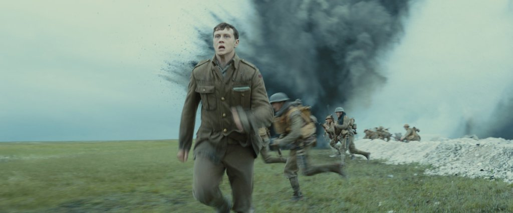 Lance Corporal Schofield (George MacKay) running along the trenches.