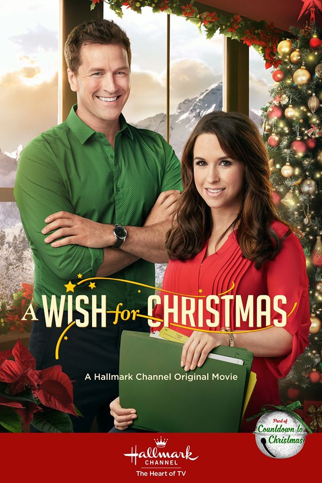 The film poster showing Peter (Paul Greene) and Sara (Lacy Chabert) standing in front of a Christmas tree.