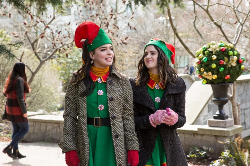 Two young women (Laura Marano, Isabella Gomez) in elf outfits.