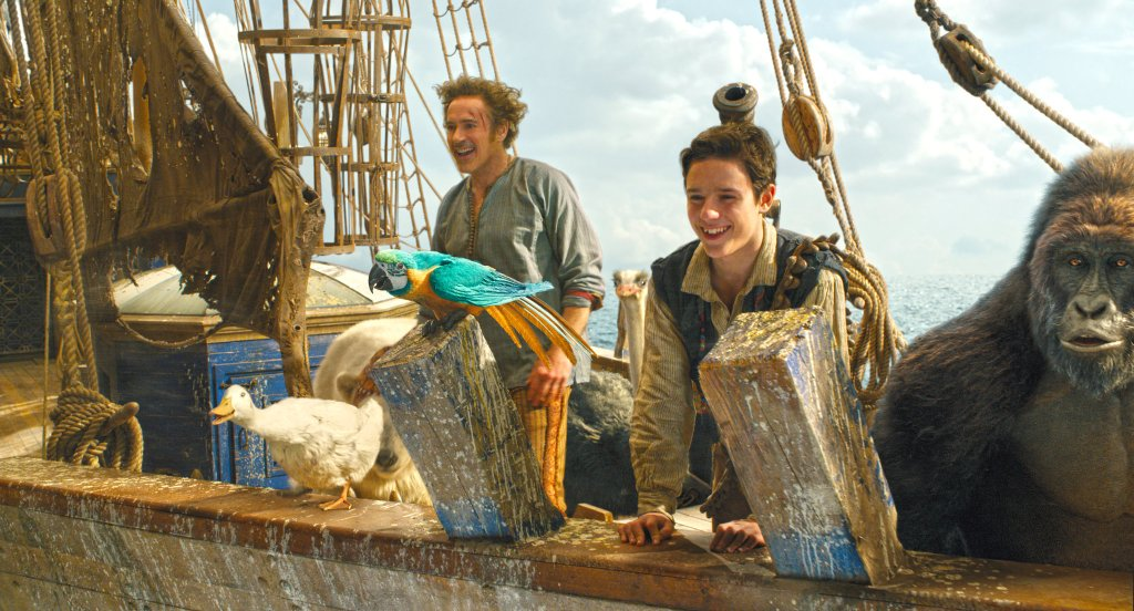 Doctor Dolittle (Robert Downey Jr.) and Tommy (Harry Collett) are sailing with a colorfil mix of animals.