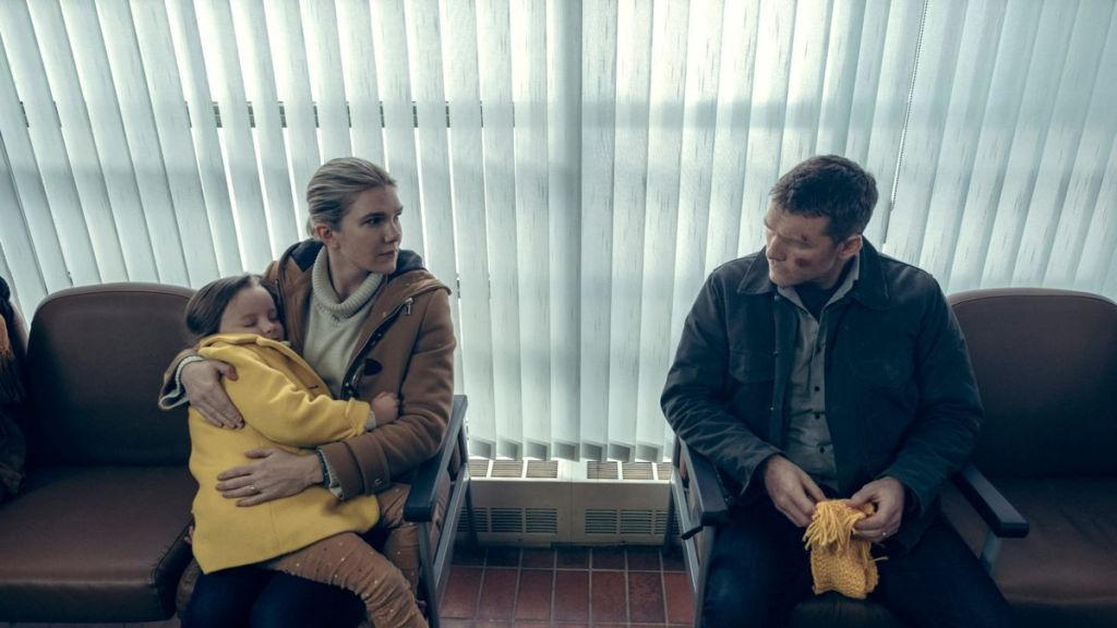 Joanne (Lily Rabe) holding their daughter Peri (Lucy Capri) as she talks to Ray (Sam Worthington) in the hospital's waiting room.