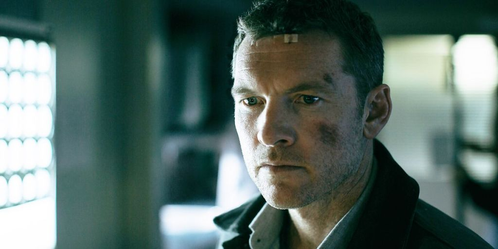 Ray (Sam Worthington) looking banged up and shocked.
