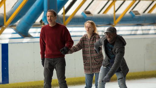 Malik (Reda Kateb) and Fabrice (Djibril Yoni) ice-skating with a client, a young woman.