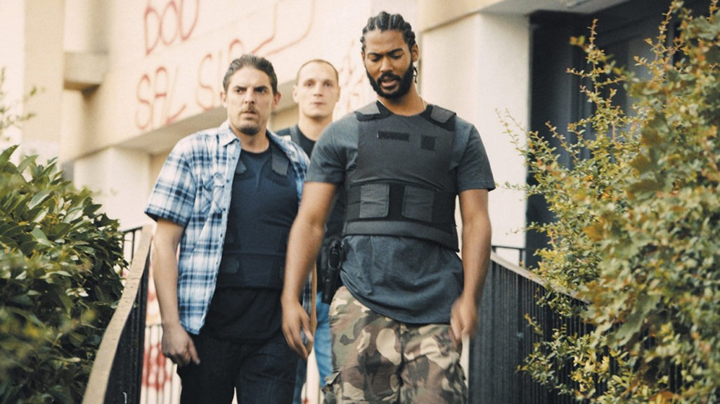 Stéphane (Damien Bonnard), Chris (Alexis Manenti) and Gwada (Djebril Zonga) leaving a house.