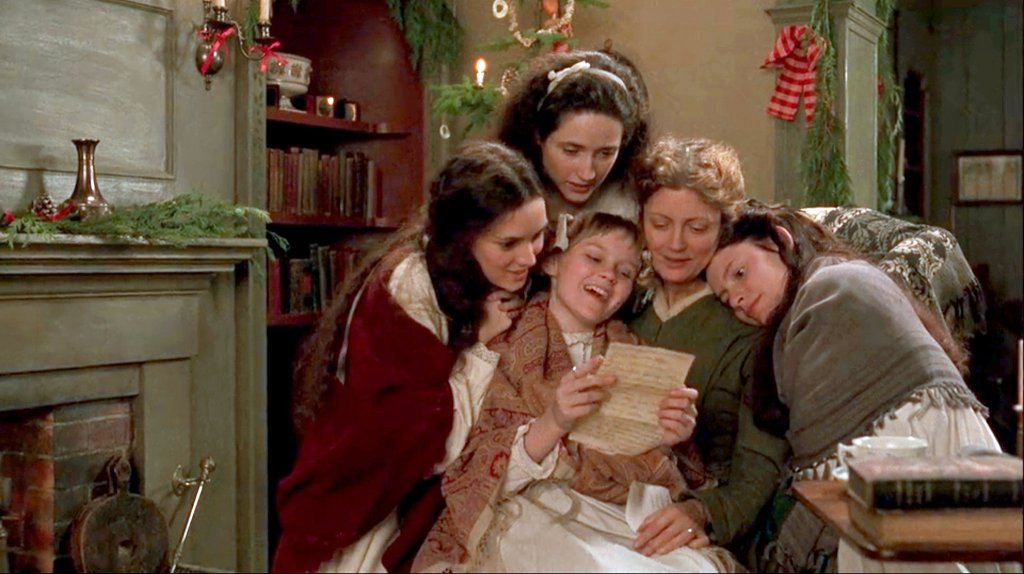 The four March girls (Winona Ryder, Trini Alvarado, Kirsten Dunst, Claire Danes) huddled around their mother (Susan Sarandon) to read a letter from their father.