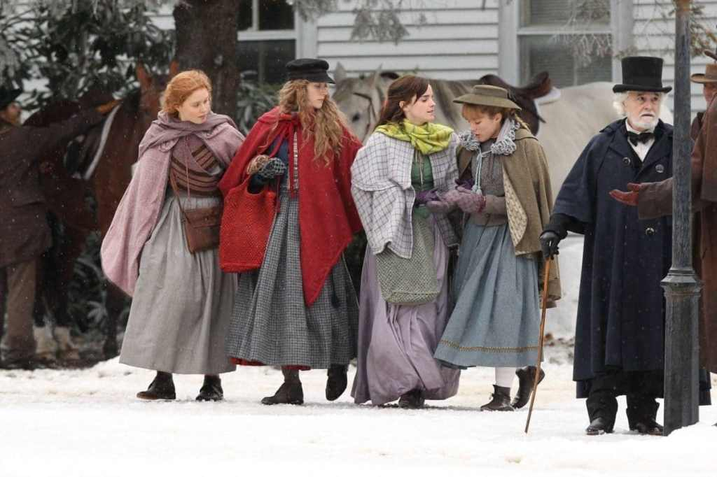 The four Marsh girls (Saoirse Ronan, Emma Watson, Florence Pugh, Eliza Scanlen) walking through town.