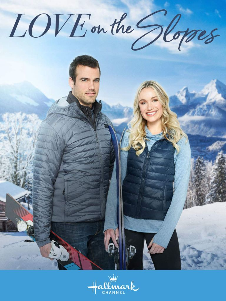 The film poster showing a man (Thomas Beaudoin) and a woman (Katrina Bowden) standing on a snowy mountain with skis in their hands.