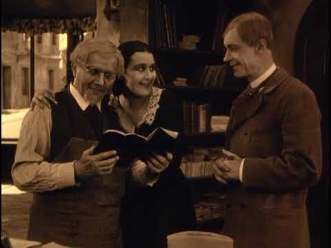 Bookbinder Starke (Karl Etlinger), his daughter Marie (Lil Dagover) and Lorenz (Alfred Abel) in Starke's shop.