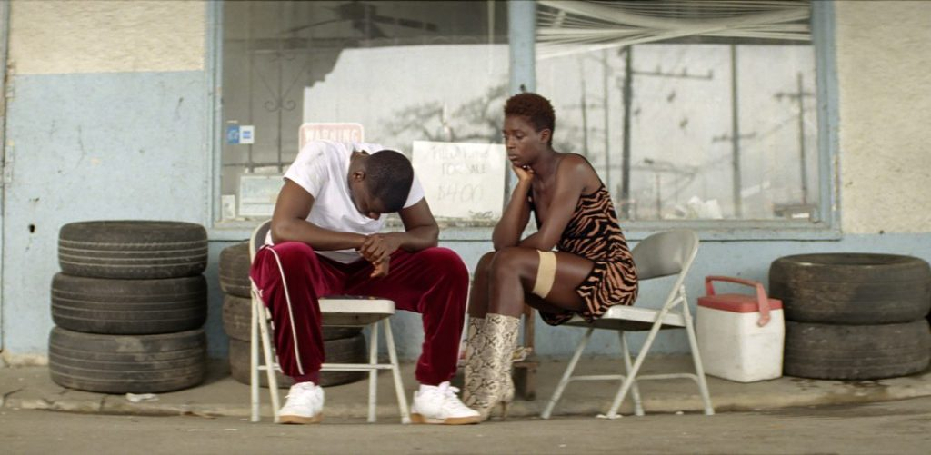 Queen (Jodie Turner-Smith) and Slim (Daniel Kaluuya) at an auto shop.