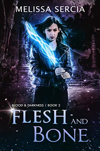The book cover showing a dark-haired woman with a glowing sword.