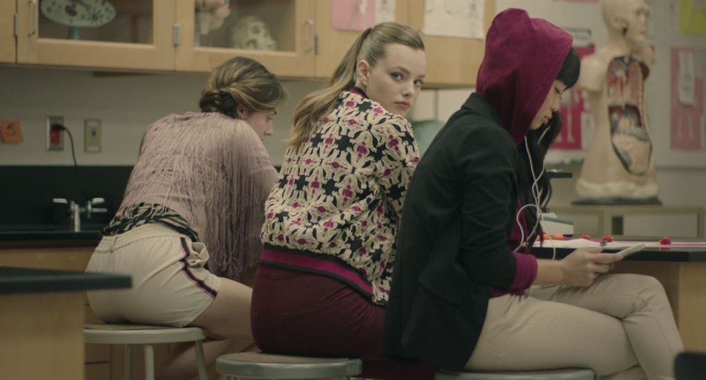 Veronica (Kristine Forseth) looking over her shoulder in class.