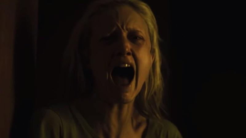 Detective Muldoon (Andrea Riseborough) screams.