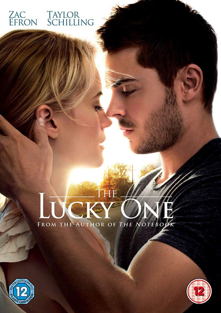 The film poster showing Logan (Zac Efron) and Beth (Taylor Schilling) almost kissing.