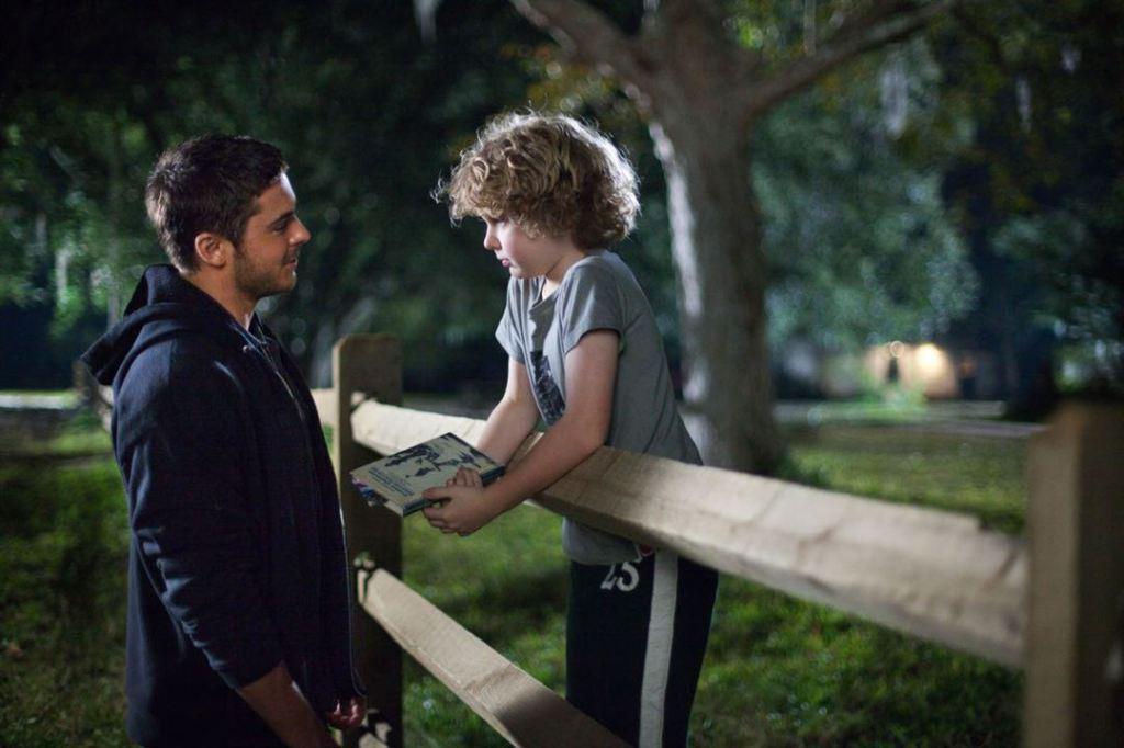 Logan (Zac Efron) talking to Ben (Riley Thomas Stewart)