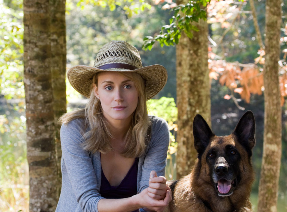 Beth (Taylor Schilling) with a dog.