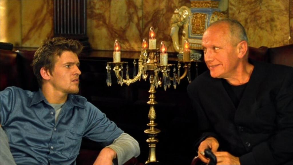 Byron (Brendan Mackey) and Jeff (Steven Berkoff) talking.