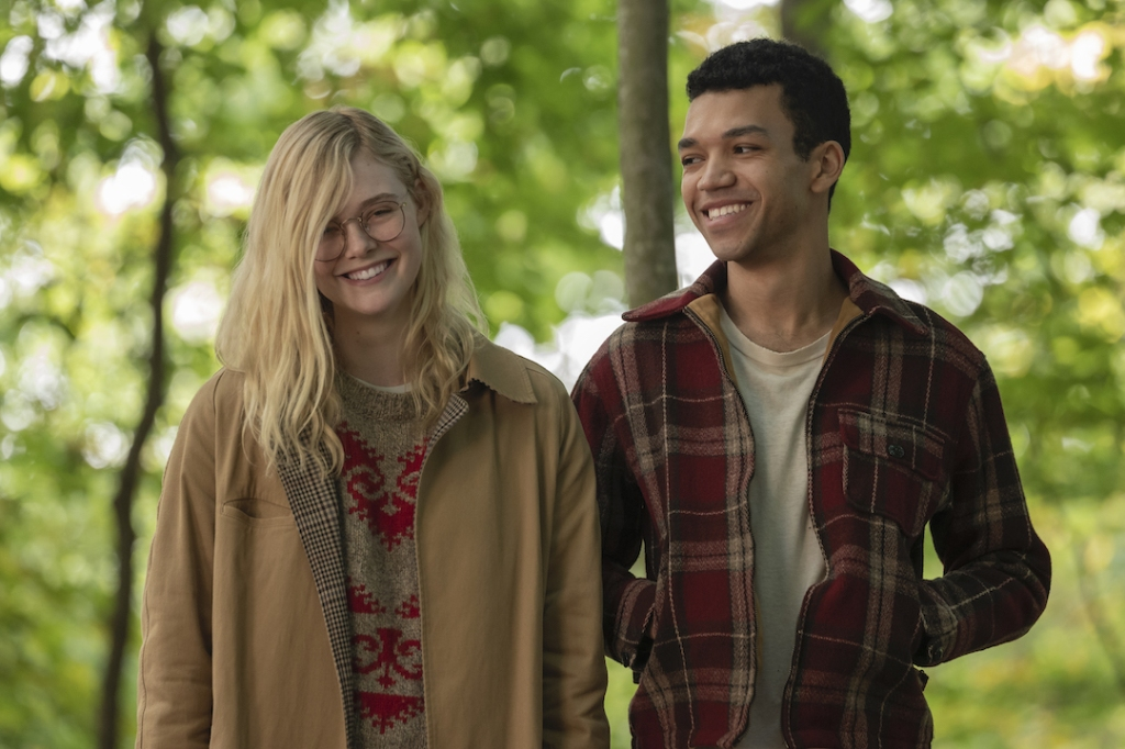 Violet (Elle Fanning) and Finch (Justice Smith) in the woods.