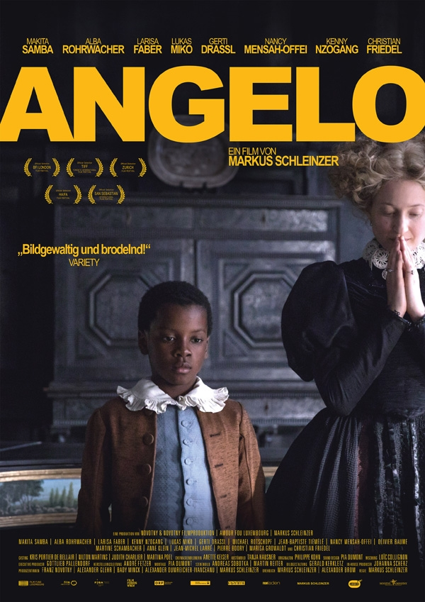 Angelo as a child (Kenny Nzogang) and the countess (Alba Rohrwacher) standing next to each other. She's praying.
